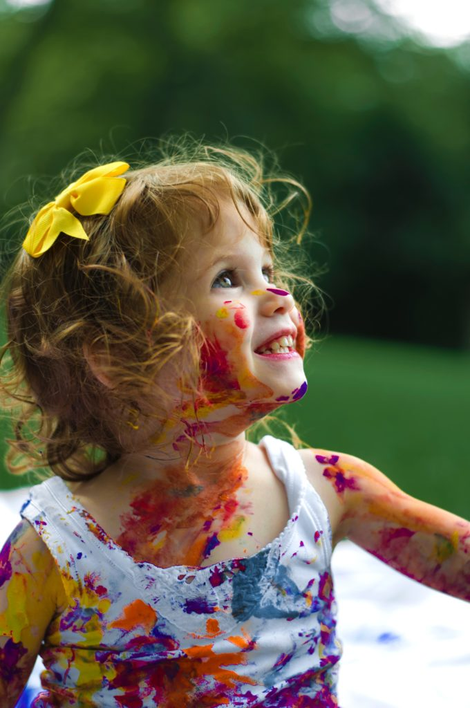 Happy girl with paint on her face. Alison Escalante MD