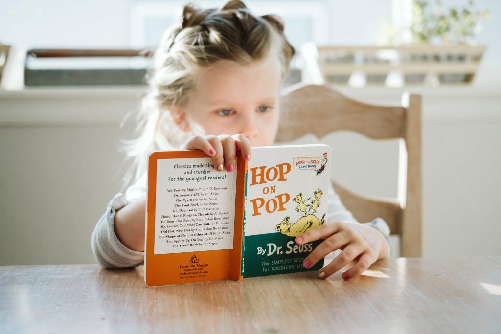 Reading child. Alison Escalante MD
